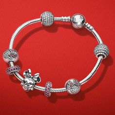 Rock the dots just like Minnie Mouse with these captivating PANDORA Disney charms in sterling silver. Hit the sweet spot by adding them to your bracelet or sport them on feminine necklace stylings.