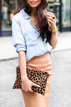 A denim top paired a neutral leather skirt and a leopard print clutch