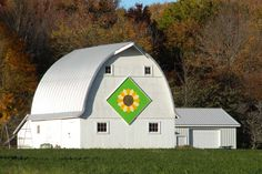 Folk artisans painting traditional quilt patterns on barns around the country