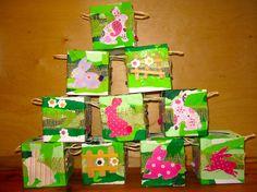 Pâques 2015 ACTIVITE 1ère MATERNELLE - A partir d'une boite carrée de mouchoirs - Collage papiers+colle à tapisser (1e couche fond blanc / 2e couche papiers déchirés en bandelettes camaïeu de verts) - collage bouton pour coeur de la fleur - piquage silhouettes lapins - collage fleurs sur la boite selon consignes math: (nombre défini sur barrière, dessus de la boite,...)
