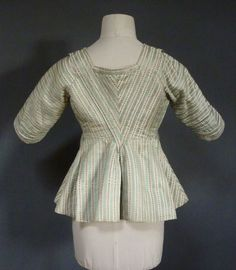 Back view, caraco, Netherland, 1770's. Silk woven with pale green stripes with a minute pattern alternating with ivory stripe woven with brown stylised flower pattern.