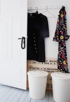 shallow entryway - paint some trash cans for: dog/cat food storage, recycle, planters...