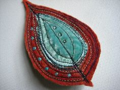 Brick red and aqua leaf brooch by Jackie Cardy Textiles