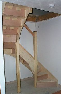 Stairs Narrow Spaces | October 2000 -- the bend in a piece of network conduit is fixed, by ...
