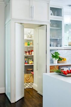 walk in pantry with food prep area. doors look like cabinet doors / almost like hidden room