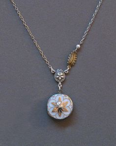 Milk Glass Locket . Vintage Button . Star Flower . Jewelry By envisage. $32.00, via Etsy.