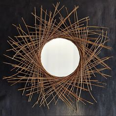 Branching out. Loosely woven twigs fan out around this lightweight, circular wall mirror, providing a natural way to nest. #Circular #Mirror