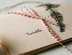 love the hand-drawn evergreen with the red/white baker's twine