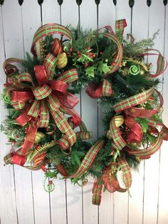 Elegant Christmas wreaths dress up any door or wall for the holidays. Greet guests with a wreath on your front door. Merry Christmas!