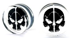 Skull plugs are made of a clear acrylic. The black skull is in the center of the acrylic plug, not on the surface. Dual flared edges. Available in 2 gauge & 0 gauge. Sold per pair. #piercethis2