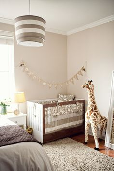 Proof That Baby in Your Bedroom Can Be Beautiful! *Neutral colors. *The acrylic and walnut Roh Crib by Spot on Square adds mod, eco-friendly style to the room. *A giant plush giraffe from Melissa & Doug sands over the crib. (Tip: while this giraffe is five feet tall, it comes with a comparable small price tag at just $63!) *A Roh changing table from Spot on Square