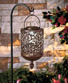 The chic scrollwork design of this Solar Scrolled Hanging Lantern refreshes the look of your porch, patio or other outdoor oasis with graceful accent lighting. A ring on the handle makes it easy to hang from any hook. It has a solar panel on top that Solar Powered Lanterns, Solar Lanterns, Candle Lanterns, Solar Pathway Lights, Solar Lights, Pathway Lighting, Backyard Lighting, Outdoor Lighting, Accent Lighting