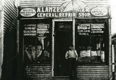"The A. Lansenlechner, General Repair in 1904, located at 142 North Main Street. The Sign just above the door reads ""razors and shears, guns and sewing machines, griding, cutlery, umbrellas, repaired and recovered."""