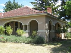 Leongatha house in the Mediterranean style. The villa is a rendered brick single storey Interwar Mediterranean style building with a multiple hipped terracotta tiled roof. House Exterior Color Schemes, Exterior Paint Colors For House, Exterior Colors, Facade House, House Roof, Mediterranean Homes Exterior, Mediterranean Architecture, Mediterranean Houses, Stucco And Stone Exterior