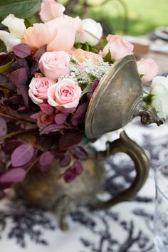 Love this look - roses in an antique silver pitcher. I have one just like it!