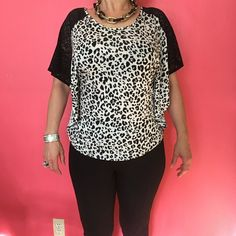 H & M brand new black and white top Brand new ladies never worn. It's a flower top that keeps you cool. :) On the shoulders there's a lace and the overall pattern of the shirt is cheetah print H&M Tops Blouses