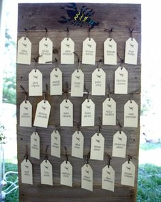 The Escort Cards    Tags hung on distressed wood boards painted with various icons such as lobsters, suns, and lighthouses, that first appeared on the couple's save-the-dates. These motifs were printed to designate table assignments.