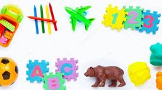 Colorful kids toys on white Premium Phot. Simple Background Design, Space Photos, Simple Backgrounds, Birds In Flight, Free Photos, Kids Toys, Nap, Concept, Colorful
