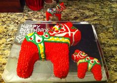 These are the first cakes I ever decorated. They're modeled after the Swedish Dala horse.