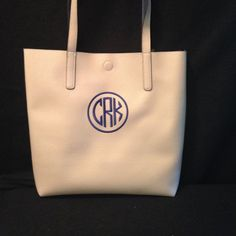 LIKE US ON FACEBOOK https://www.facebook.com/EmbroideredMemorys/ Monogrammed Tote Bag/purse I use mine as a purse! What a wonderful multi purpose bag and makes a GREAT CHRISTMAS GIFT!  PRICE includes embroidered Monogram in a thread of your choice.  Tote size is approx. 12 x 15  faux leather tote handbag, double handles, magnetic closure  CONVO me with Monogram letters EX: CRK on this one C = first name R = last name K = middle name GIVE ME THE LETTERS IN EXACT ORDER THAT YOU WANT THEM ON…