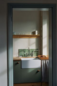 The kitchen was gut renovated and 1934 designed cabinets with soft-closing hinges and doors. They're fitted with oversize door knobs (wood knobs found at North Road Timber & Joinery in Brighton) inspired by the 1930s kitchen at the Werkbund Estate in Vienna.