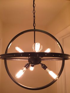 We created this atomic piece from a 20 and 22 rim. We custom made a Sputnik light fixture and suspended it inside the rims. The finish is a custom charcoal grey metallic. It uses six 60 watt max bulbs. We used 40 watt in our pictures. This piece comes fully assembled and is ready for ceiling mounting out of the box. The piece, as pictured here, hangs 34 inches from the ceiling. We can adjust the length up or down at no extra charge :) Just ask when ordering. If you would like any other…