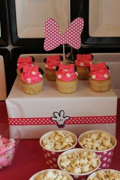 Cupcakes and popcorn at a Minnie Mouse party! See more party planning ideas at CatchMyParty.com!