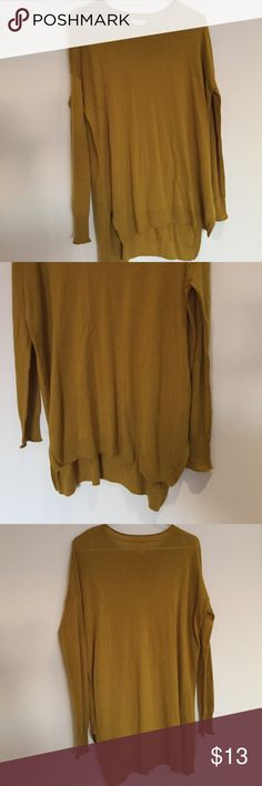 """H&M Mustard Oversize Colored Long  Sleeve Top This cool mustard color long dressy tee top is 25"""" measured across and 26"""" long in front and 30"""" in back. Great with skinny jeans! It is made of 50% Acrylic and 50% Viscose and feels like a light weight sweater and hangs great. You will love this and it is in brand new never worn condition. H&M Tops Tees - Long Sleeve"""