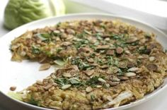 Okonomiyaki - Japanese pizza  - 160 gr cabbage - 80 gr leek - 60 gr spelt flour - 2 bio eggs - seasalt - chives - shaved almonds - any topping you like - large pan, small pan  Mix salt, flour, leek and cabbage. Add eggs and make a sticky whole. Warm up a large pan with olive oil in it. Put the sticky mess in it and push down with a spatula. Bake for 5 mins and turn around. Grill shaved almonds. Put your topping of choice on it. Bon appetit!