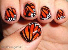 diseño alas de mariposa en uñas
