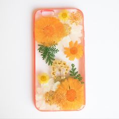The orange daisy pressed flower bumper phone case