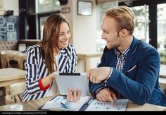 Young woman and man at a business meeting in a cafe - stock photo