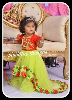 Cute little darling dressed up with specially designed frock at her birthday party.