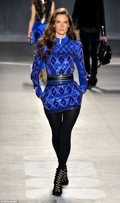 Wow moment: All eyes were on Alessandra as she paraded down the runway in her electric blue outfit