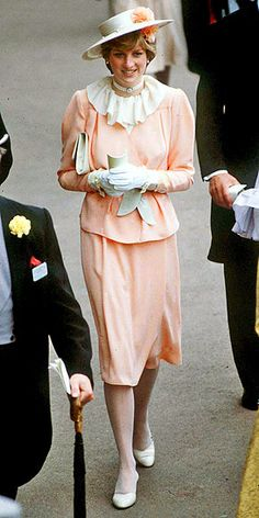 People:  THE CONSERVATIVE YEARS: 1980-1985 photo | Diana stepped out in a coordinated hat (one of her style signatures) and pale pink suit in 1981 at the Ascot Racecourse.  Credit: Tim Graham/AP