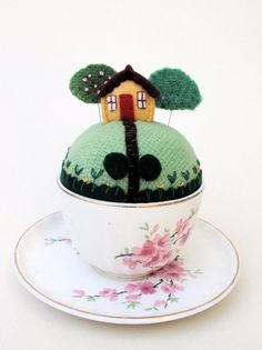 tiny pincushion world in a teacup