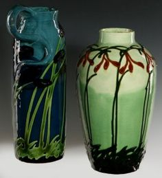 Max Lauger (1864-1952) Art Nouveau Influence Pottery, Two art pottery vases slip decorated with florals of Art Nouveau influence, signed on the bases with the artist's impressed mark and with the 'Muster Gesetzl Geschtzt' copyright mark