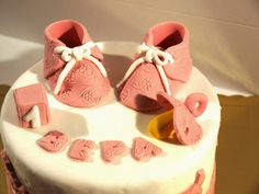 Cakes constructed ​​from sugar paste: Baptism cake and cookies