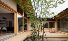 Japanese architect Takashi Okuno practices nature-fused architecture with Hiiragi's House, a modern Japanese-style residence built around a courtyard and old tree.