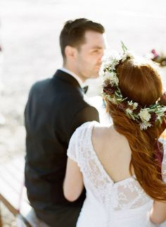 We love this bride's floral crown and deep-v back gown! #winter #weddings #floralcrown #bridalfashion #wintercrown