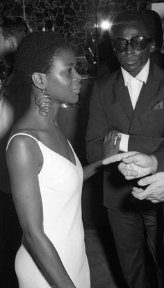 "Cicely Tyson & Miles Davis 1968. Cicely Tyson was the 1st ""Negro"" actress on TV not playing a maid.She was in a TV series with a very famous actor (whose name I can't of course remember) filmed on the strs. of NY. She shocked,I mean SHOCKED the country, because SHE WAS the 1st black women to not have straightened hair AND had an afro & a very short afro! NO ONE HAD SEEN THIS BEFORE. No one knew what this style was,or what to CALL it.The term afro hadn't been ""invented"" yet. Biddy Craft"