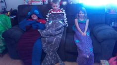 A Dragon, A Shark and a Mermaid sleep sack. 2 are my creations and the other is from a pattern but I modified it