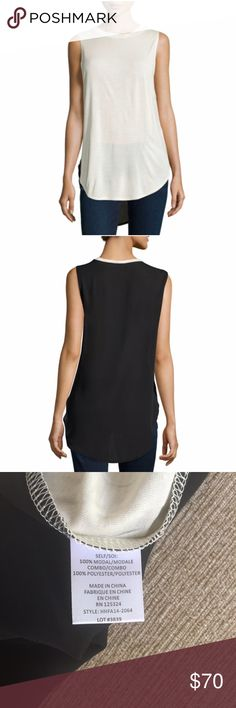 Haute Hippie High-Low Knit Tank Lightweight jersey-knit tank with black crepe back. Crew neckline with high-low hem. Handwash or dry clean. 100% modal.   ✨Reasonable offers considered ✨Bundle discounts offered Haute Hippie Tops Tank Tops