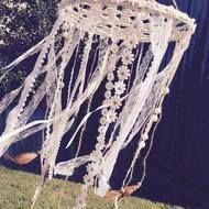 Gorgeous handcrafted crochet doily dream-catcher. This is a mobile style. It features bronze flower charms, a variety of beads, pastel pink laces, fluffy feathers and cute daisy ribbons. Its diameter is 30cm and its truly enchanting. Its made to the hi...