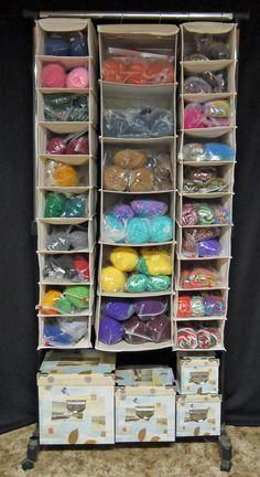 1 rolling garment rack + 1 hanging sweater organizer + 2 hanging shoe organizers = 1 perfect storage unit for all of my yarn.