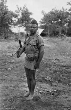427 Sergeant Bengari, MM of A Company, Papuan Infantry Battalion, who has 104 Japanese to his credit and has been recommended for the DCM. Hansa Bay - Sepik River Area, New Guinea. 5th Aug 1944