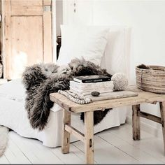 White linen, recycled wood benches, Icelandic furs, shell decor. So Bisque Interiors. Our linen pods are all back in stock again! x  www.bisqueinteriors.com.au for wholesale  www.brauerbirds.com.au for retail  Image via Pinterest