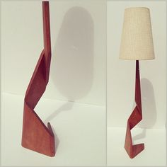 A teak angular base twists up and terminates into a vintage linen lamp shade. $495