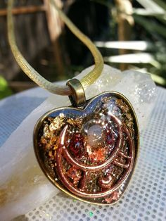 Hey, I found this really awesome Etsy listing at https://www.etsy.com/listing/207720877/crystal-orgonite-healing-heart-necklace