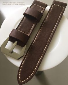 """26mm 90-160 coffee brown and """"golden"""" thread. Handpolished GPF-Mod dep buckle. Very comfortable and superbly matches a brown panerai dial.  Order your custom watch strap at mhtsanders@gmail.com instagram DM or have a look athandmadewatchstrap.com Handmade by Mark Sanders #handmadewatchstrap #handmadestrap #panerai #paneristi #customwatchstrap #ammostrap #vintagestrap #officinepanerai #leather #paneraistraps  #paneraiwatch #paneraicentral #paneraipics #watchnerd #wristshot #paneraistrap…"""